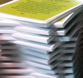 collated loose sheets with a slip sheet divider between each set